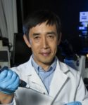 Ximing Guo of the Rutgers University Haskins Shellfish Laboratory. Rutgers photo.