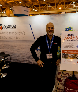 A smiling exhibitor in his booth at the International WorkBoat Show