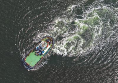 Tugboat towing in the ocean