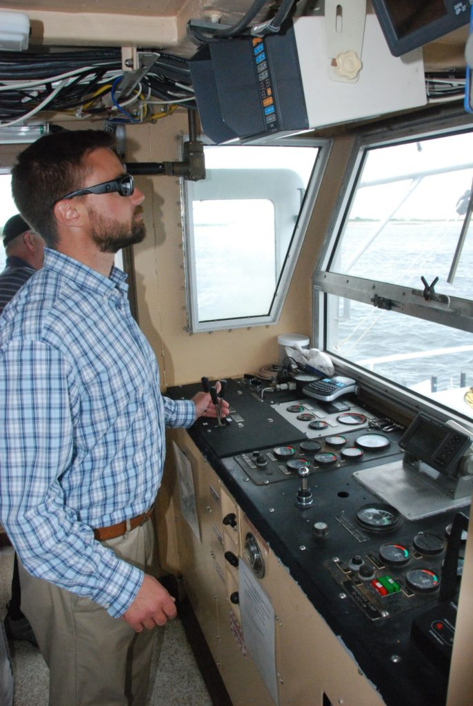 Peter Plantamura, who was captain of the Nauvoo during her time in NOAA service, operates the winch controls. Kirk Moore photo.