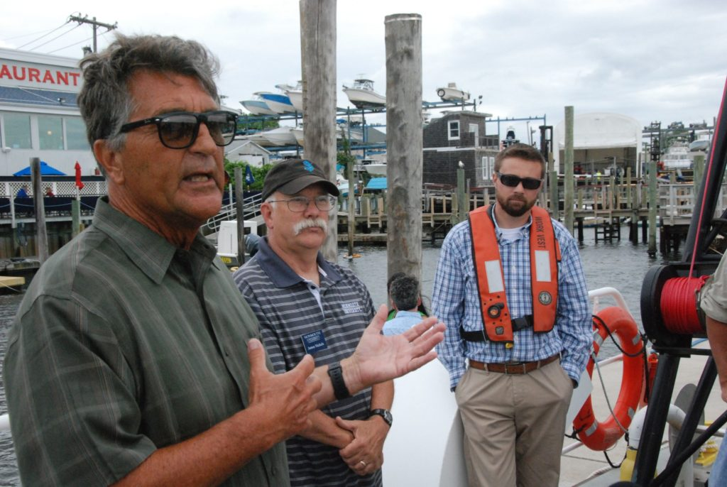 John Tiedemann, assistant dean of the school of science at Monmouth University, explains the Nauvoo's missions with captain and professor Jim Nickels, center, and NOAA captain Peter Plantamura. Kirk Moore photo.